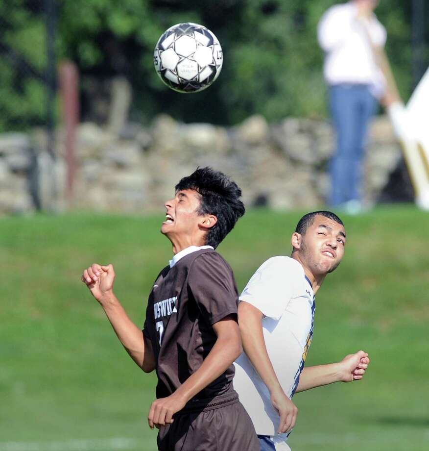 Aaryan Chinai (#7) of Brunswick, left, and a Trinity-Pawling player go to head the ball during the boys high school soccer match between Brunswick School and Trinity-Pawling School at Brunswick in Greenwich, Conn., Wednesday, Oct. 10, 2018. Photo: Bob Luckey Jr. / Hearst Connecticut Media / Greenwich Time