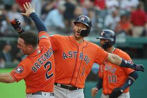 CLEVELAND, OH - OCTOBER 08:  Carlos Correa #1 of the Houston Astros celebrates with Alex Bregman #2 after hitting a three-run home run in the eighth inning against the Cleveland Indians during Game Three of the American League Division Series at Progressive Field on October 8, 2018 in Cleveland, Ohio.  (Photo by Gregory Shamus/Getty Images)