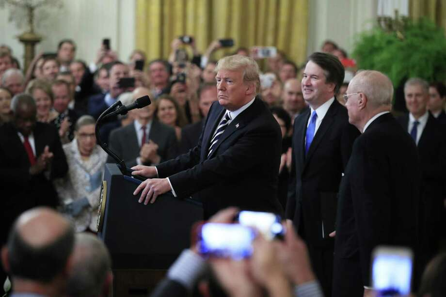 President Donald Trump, from left, arrives with Justice Brett Kavanaugh and retired Justice Anthony Kennedy for the ceremonial swearing-in ceremony of Kavanaugh as Associate Justice of the Supreme Court of the United States in the East Room of the White House in Washington, Monday, Oct. 8, 2018. Photo: Manuel Balce Ceneta, STF / Associated Press / Copyright 2018 The Associated Press. All rights reserved.