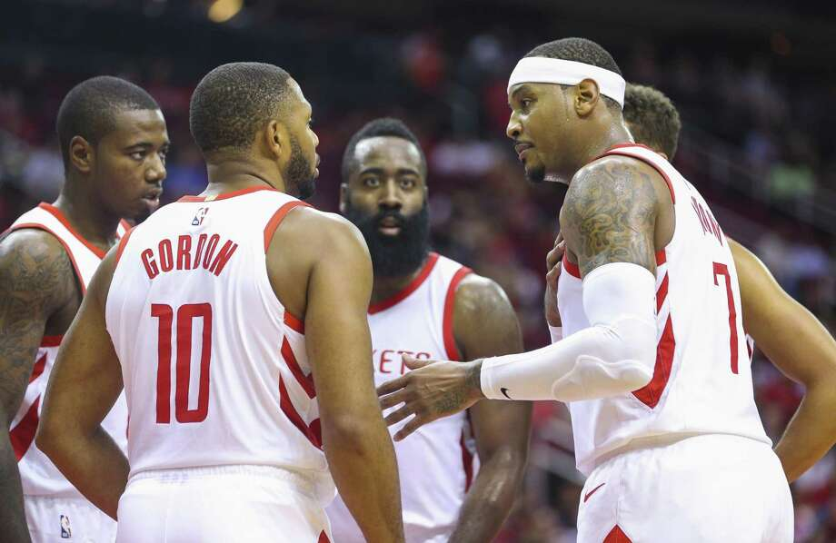 Houston Rockets guard Eric Gordon (10), guard James Harden and forward Carmelo Anthony huddle during the second half of a game between the Houston Rockets and the Indiana Pacers at Toyota Center, Thursday, Oct. 4, 2018 in Houston. Photo: Mark Mulligan, Houston Chronicle / Staff Photographer / © 2018 Mark Mulligan / Houston Chronicle