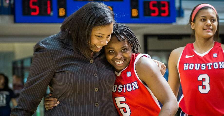 Houston guard Porsche Landry (5) celebrates with assistant coach Ravon Justice following a 53-51 victory over Rice in a college basketball game at Tudor Fieldhouse, Sunday, Feb. 10, 2013, in Houston. ( Smiley N. Pool / Houston Chronicle ) Photo: Smiley N. Pool/Houston Chronicle