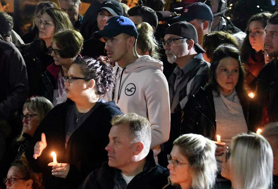 Family members and friends gather for a candlelight vigil memorial at Mohawk Valley Gateway Overlook Pedestrian Bridge in Amsterdam, N.Y., Monday, Oct. 8, 2018. The memorial honored 20 people who died in Saturday's fatal limousine crash in Schoharie, N.Y., (AP Photo/Hans Pennink) Photo: Hans Pennink / Hans Pennink