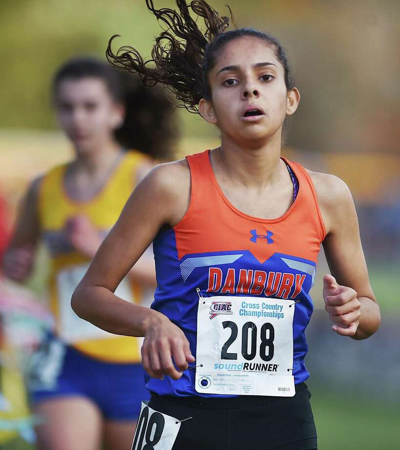 Danbury's Alexandra Chakar finishes 7th in 19:59 at the the CIAC Class LL state cross country championships on Oct. 28, 2017. Photo: Catherine Avalone / Hearst Connecticut Media / New Haven Register