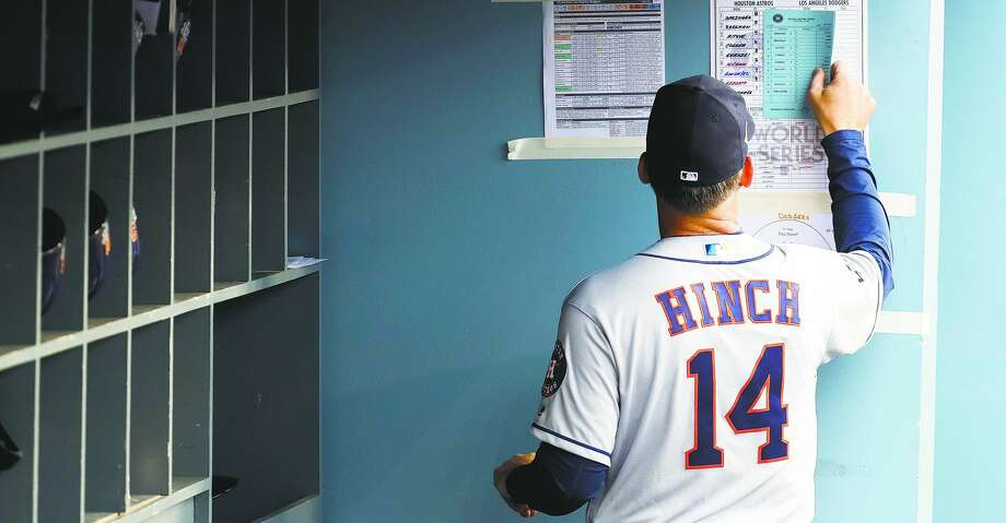 Houston Astros manager A.J. Hinch (14) compares lineups before Game 6 of the World Series at Dodger Stadium on Tuesday, Oct. 31, 2017, in Los Angeles. ( Karen Warren  / Houston Chronicle ) Photo: Karen Warren/Houston Chronicle