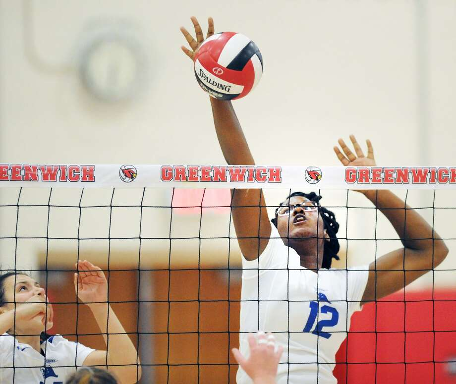 Darien's Hassana Arbubakrr spikes the ball during a match against Greenwich on Sept. 21. Photo: Bob Luckey Jr. / Hearst Connecticut Media / Greenwich Time