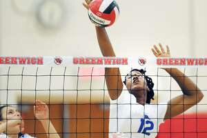 Darien's Hassana Arbubakrr spikes the ball during a match against Greenwich on Sept. 21.