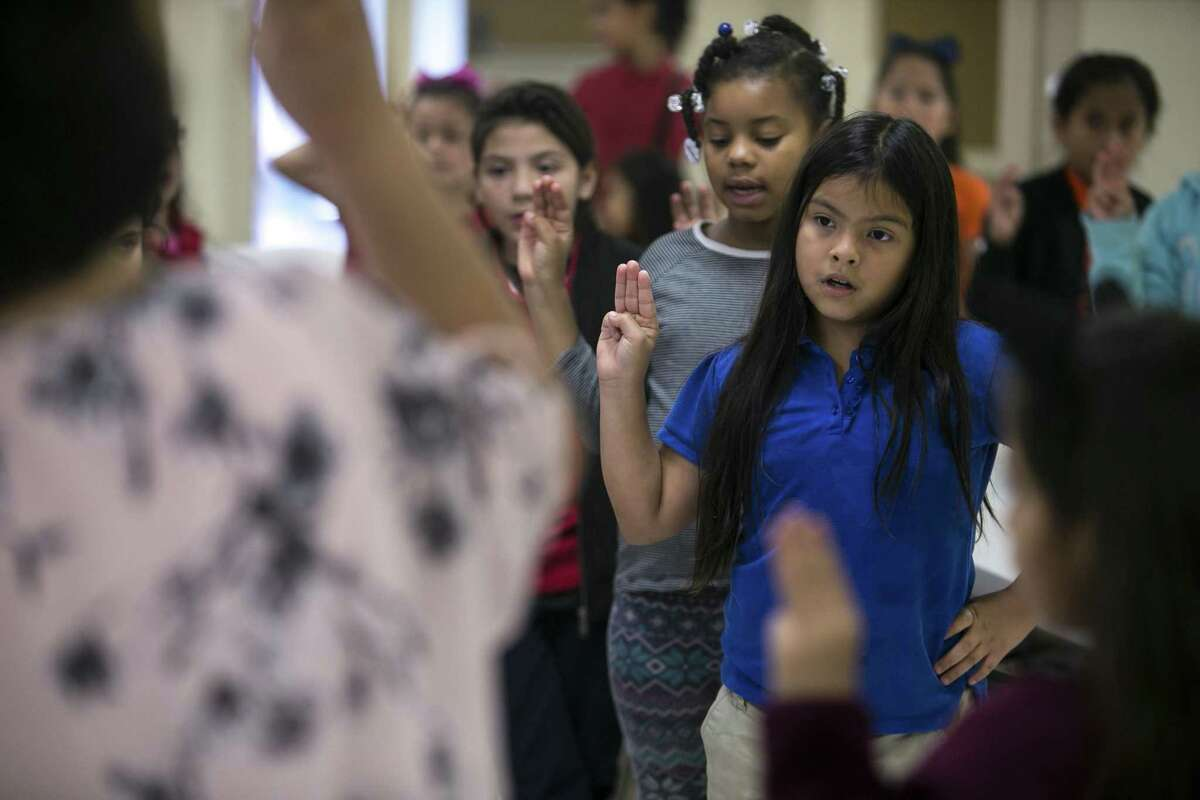 Karina Martinez, 8, recites the Girl Scout Pledge on Wednesday during the after-school program at the West Side Girl Scout Leadership Center.