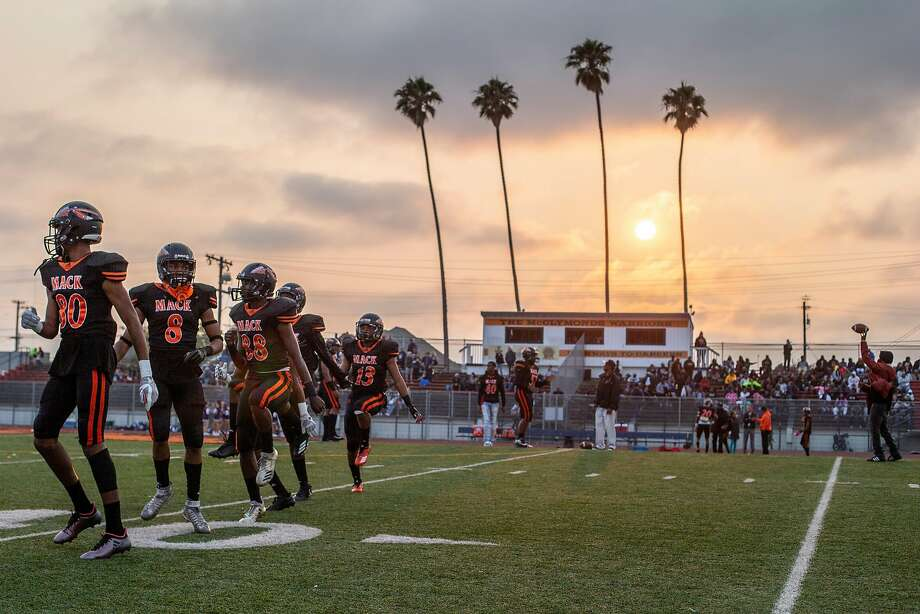 The Warriors before a high school football game between the McClymonds Warriors and Marin Catholic Wildcats at McClymonds High School on Friday, Aug. 24, 2018, in Oakland, Calif. Photo: Santiago Mejia / The Chronicle