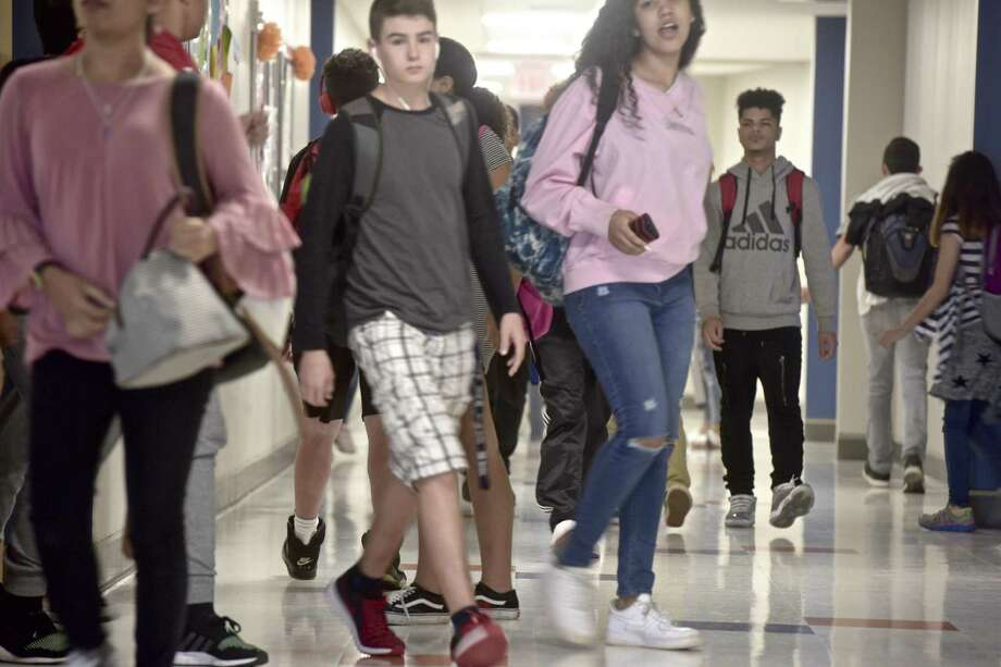Students fill the hallway of the new addition at Danbury High School between classes on Wednesday, October 10, 2018, in Danbury, Conn. Photo: H John Voorhees III / Hearst Connecticut Media / The News-Times