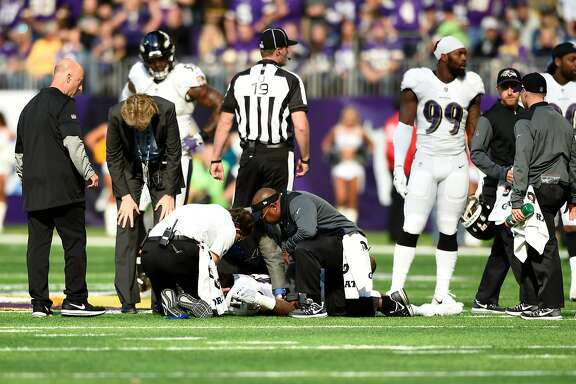 MINNEAPOLIS, MN - OCTOBER 22: Mike Wallace #17 of the Baltimore Ravens lies on the field while being assessed by medical staff in the first quarter of the game against the Minnesota Vikings on October 22, 2017 at U.S. Bank Stadium in Minneapolis, Minnesota. Wallace was ruled out of the game with a concussion. (Photo by Hannah Foslien/Getty Images)