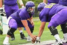 UAlbany offensive lineman Niko Culnan, left, runs drills during football practice at Casey Stadium on Tuesday, Aug. 21, 2018 in Albany, N.Y. (Lori Van Buren/Times Union)