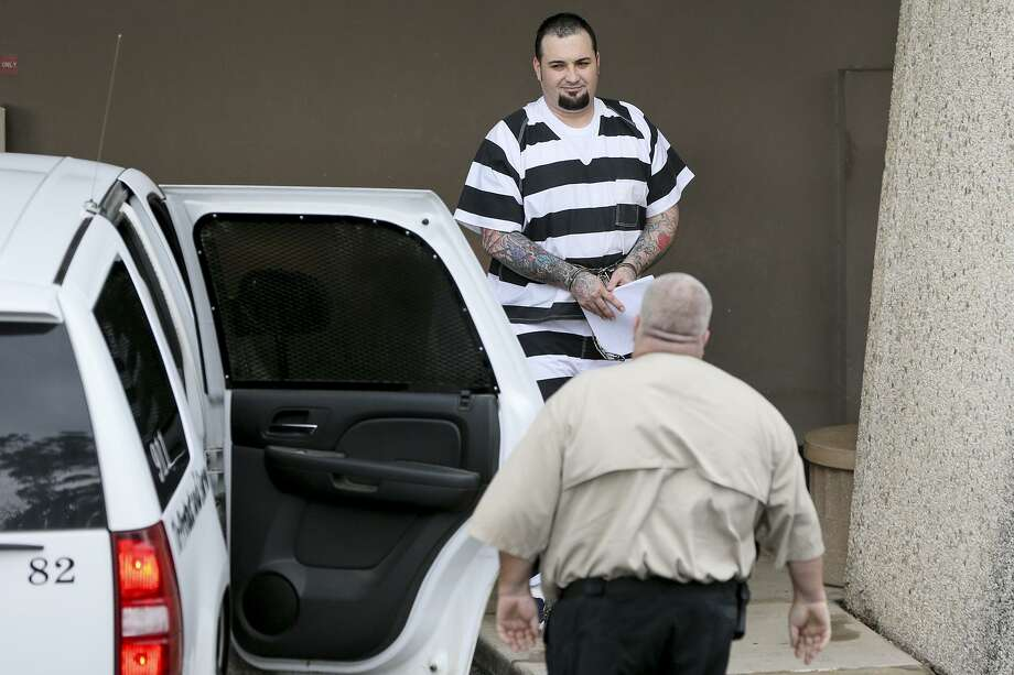 Justin Cole Forster, the reputed national sergeant-at-arms of the Bandios Motorcycle Club, prepares to enter a Wlson County Sheriffs' van outside the federal courthouse after pleading guilty for his role in a racketeering case targeting him and two other national heads of the organization on Friday, Oct. 7, 2016. MARVIN PFEIFFER/ mpfeiffer@express-news.net Photo: Marvin Pfeiffer, Staff / San Antonio Express-News / Express-News 2016