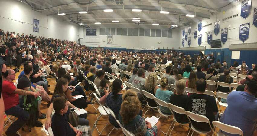 People who live in Schoharie, where 20 people died in Saturday's limousine wreck, gathered Wednesday night, Oct. 10, at the high school gymnasium for a vigil.