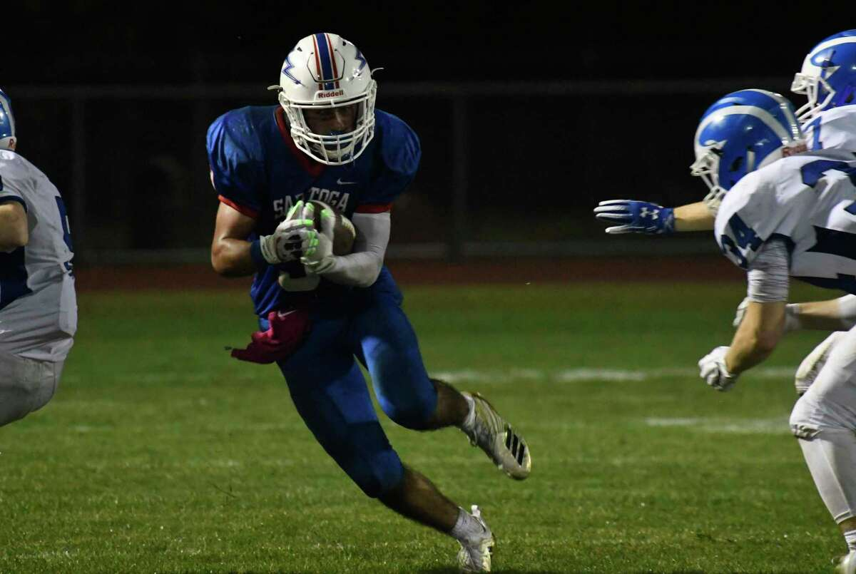 Saratoga wide receiver Christian Kondo makes for a gap in Shaker defense to make a first down during a game on Friday, Sept. 14, 2018, in Saratoga Springs, N.Y. (Jenn March, Special to the Times Union)