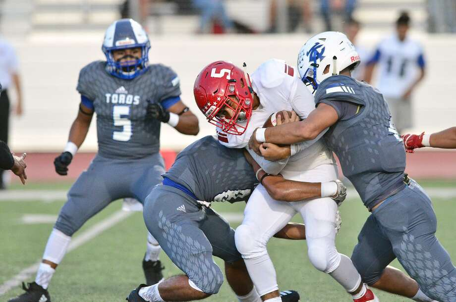 Tigers' running back Miguel Sanchez is tackled by a pair of Cigarroa Toros at Shirley Field Friday, September 14, 2018. Photo: Cuate Santos /Laredo Morning Times File / Laredo Morning Times