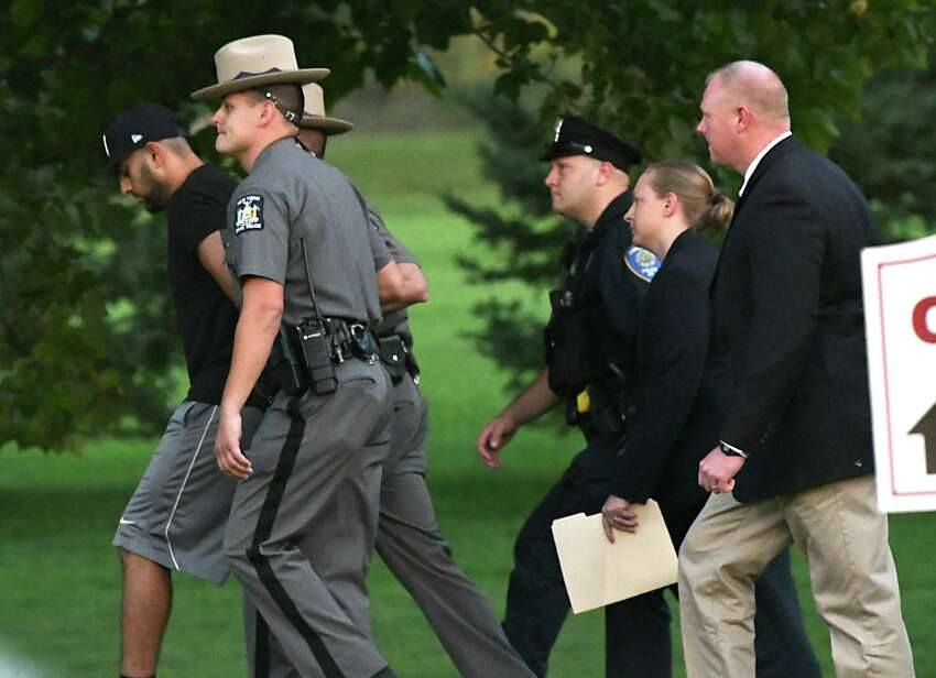 Nauman Hussain, operator of Prestige Limousine, left, arrives for his arraignment at Cobleskill Town Court for his involvement in the Schoharie limo crash on Wednesday, Oct. 10, 2018 in Cobleskill, N.Y. (Lori Van Buren/Times Union)