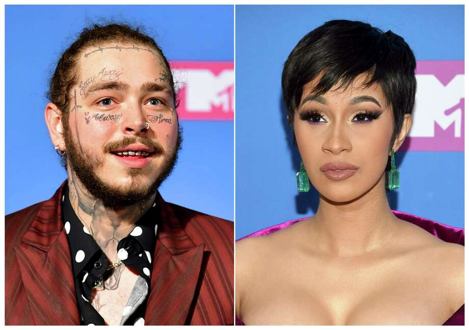This combination photo shows rappers Post Malone, left, and Cardi B at the MTV Video Music Awards in New York on Aug. 20, 2018. Cardi B and Post Malone marked major breakthroughs in the last year, but the rap stars won't compete for best new artist at the 2019 Grammy Awards. (Photo by Evan Agostini/Invision/AP) Photo: Evan Agostini / 2018 Invision