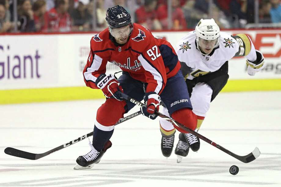WASHINGTON, DC - OCTOBER 10: Evgeny Kuznetsov #92 of the Washington Capitals skates past Tomas Nosek #92 of the Vegas Golden Knights during the second period at Capital One Arena on October 10, 2018 in Washington, DC. (Photo by Patrick Smith/Getty Images) Photo: Patrick Smith / 2018 Getty Images