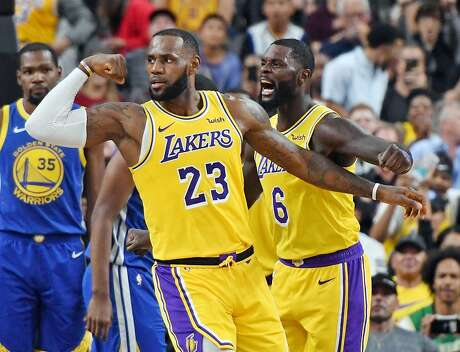 LAS VEGAS, NEVADA - OCTOBER 10:  LeBron James #23 and Lance Stephenson #6 of the Los Angeles Lakers celebrate after James made a shot against the Golden State Warriors and was fouled during their preseason game at T-Mobile Arena on October 10, 2018 in Las Vegas, Nevada. NOTE TO USER: User expressly acknowledges and agrees that, by downloading and or using this photograph, User is consenting to the terms and conditions of the Getty Images License Agreement.  (Photo by Ethan Miller/Getty Images)