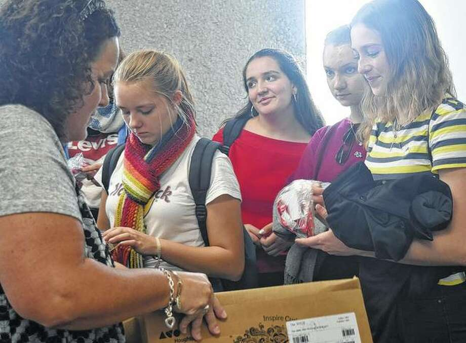 Jacksonville Schools Foundation Director Amy Albers hands out goodie bags Wednesday to German students visiting Jacksonville for the month.