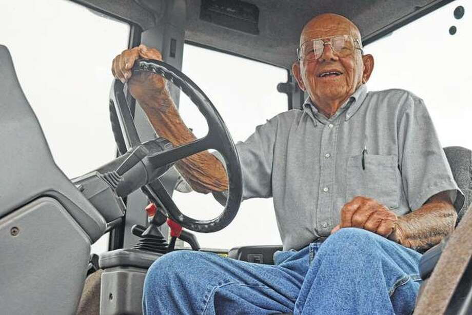 Farmer Gordon Hankins of Waverly in one of his tractors. Photo: Nick Draper | Journal-Courier