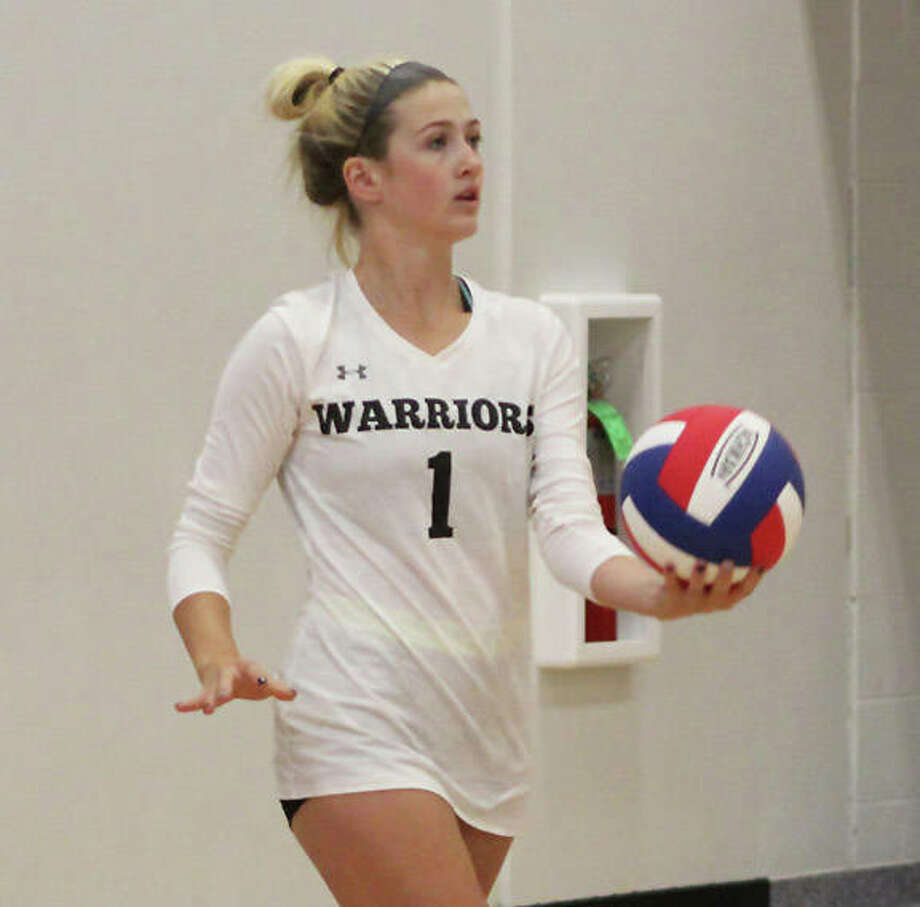 Calhoun senior libero Sophie Lorton, shown serving in a match earlier this season, had a pair of aces and made 13 digs in the Warriors' loss to Jacksonville Routt in Hardin. Routt finishes 10-0 in the WIVC. Photo: Greg Shashack / The Telegraph