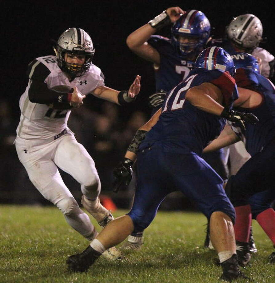West Central's Ryan Moore takes off with the ball during a high school football game at Pleasant Hill last Thursday night. Photo: Dennis Mathes | Journal-Courier