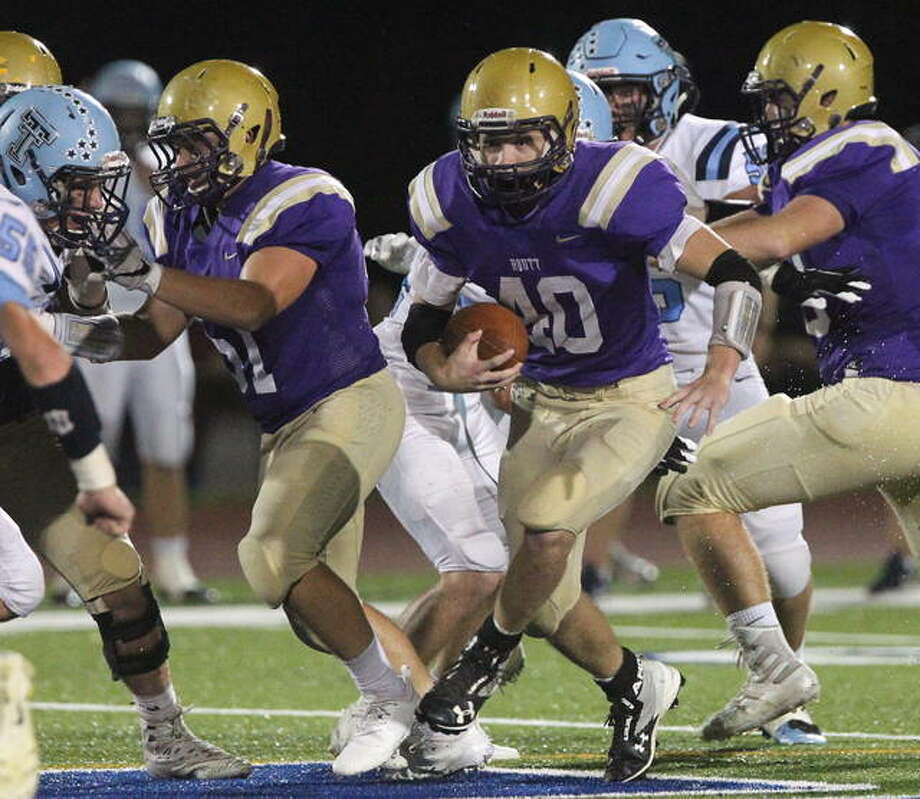 Routt's Dylan Marshall finds an opening during a high school football game against Triopia earlier this season.