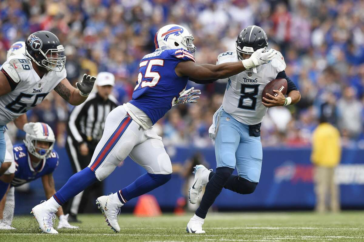 BUFFALO, NY - OCTOBER 07: Quarterback Marcus Mariota #8 of the Tennessee Titans fumbles the ball as he is sacked by defensive end Jerry Hughes #55 of the Buffalo Bills in the fourth quarter at New Era Field on October 7, 2018 in Buffalo, New York. (Photo by Patrick McDermott/Getty Images)
