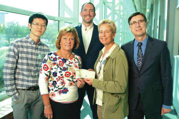 In front, from left: SIBA Chief Executive Officer Donna Richter presents a $20,000 check to SIUE's Anne Werner, PhD, associate professor and chair of the Department of Construction. In back, from left: Assistant Professor Chenxi Yuan, PhD, Associate Dean Chris Gordon, PhD, and Dean Cem Karacal, PhD.