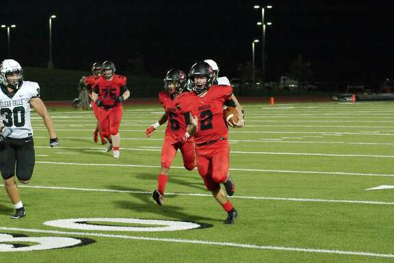 Clear Brook quarterback Shane Porter (2) finds running room against Clear Falls Friday at Challenger Columbia Stadium.