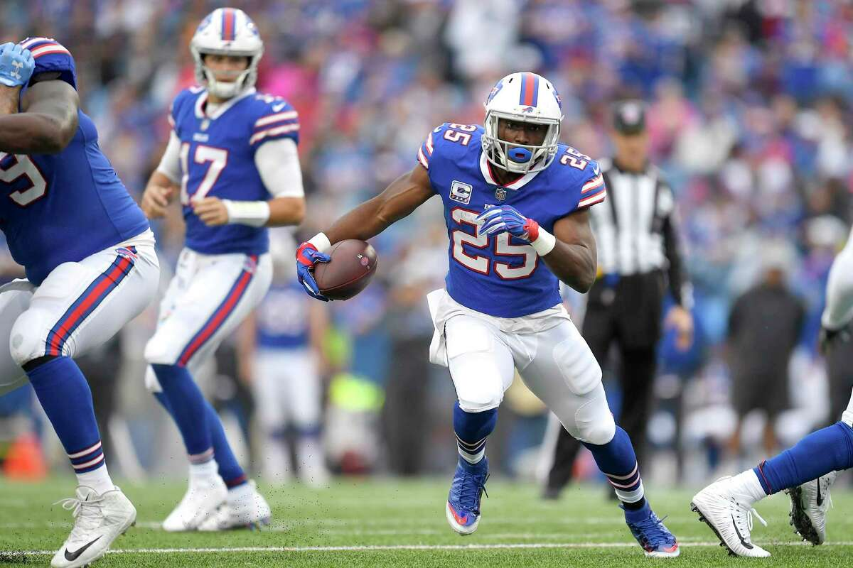Buffalo Bills running back LeSean McCoy (25) runs with the ball during the first half of an NFL football game against the Tennessee Titans, Sunday, Oct. 7, 2018, in Orchard Park, N.Y. (AP Photo/Adrian Kraus)