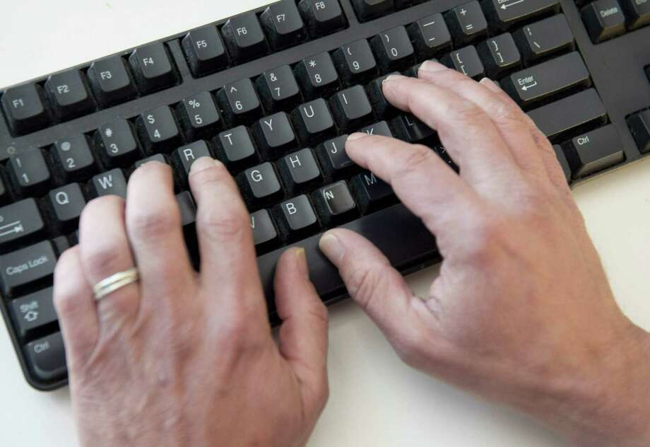 """(FILES) In this file photo taken on November 21, 2016 a man types on a computer keyboard in this photo illustration taken in Washington, DC. - An elite group of North Korean hackers has been identified as the source of a wave of cyberattacks on global banks that has netted """"hundreds of millions"""" of dollars, security researchers said on October 3, 2018. A report by the cybersecurity firm FireEye said the newly identified group dubbed APT38 is distinct from but linked to other North Korean hacking operations, and has the mission of raising funds for the isolated Pyongyang regime. (Photo by SAUL LOEB / AFP)SAUL LOEB/AFP/Getty Images Photo: File Photo / AFP or licensors"""