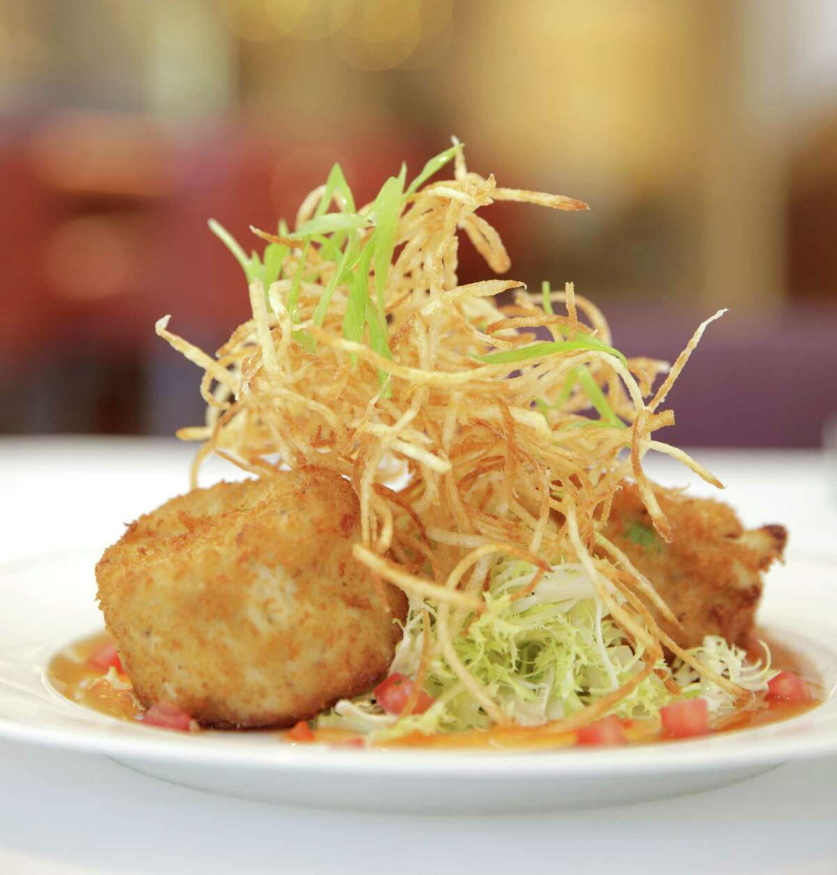 Crab cakes served at Cultivated F+B, the new restaurant in the redesigned Hotel Lancaster, 701 Texas.