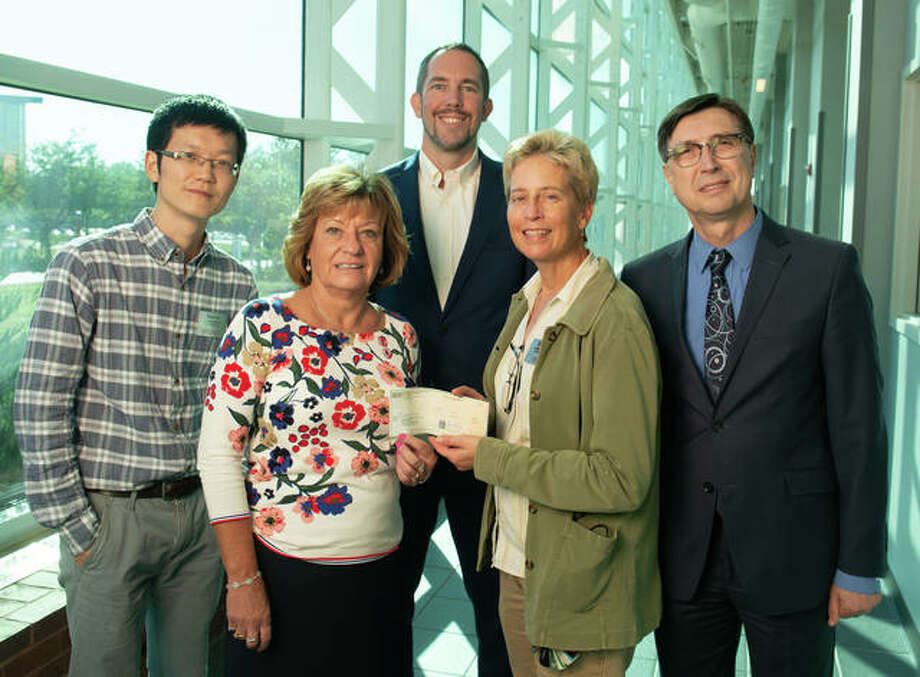 SIBA Chief Executive Officer Donna Richter presents a $20,000 check to SIUE's Anne Werner, PhD, associate professor and chair of the Department of Construction, and, from back left, Assistant Professor Chenxi Yuan, PhD, Associate Dean Chris Gordon, PhD, and Dean Cem Karacal, PhD. Photo: For The Telegraph