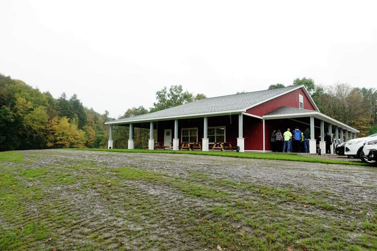 People gather for a ribbon cutting event at the East Greenbush Town Park for the newly completed $618,000 park building on Thursday, Oct. 11, 2018, in East Greenbush, N.Y. The Red Barn, as the building is named, was built using parks and recreation fees collected from developers. (Paul Buckowski/Times Union)