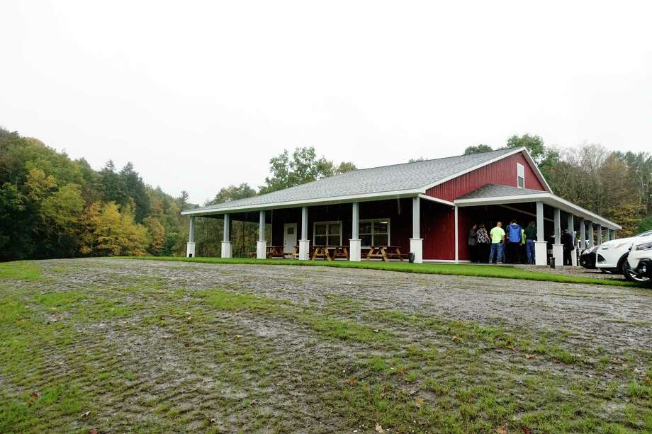 People gather for a ribbon cutting event at the East Greenbush Town Park for the newly completed $618,000 park building on Thursday, Oct. 11, 2018, in East Greenbush, N.Y. The Red Barn, as the building is named, was built using parks and recreation fees collected from developers.  (Paul Buckowski/Times Union) Photo: Paul Buckowski, Albany Times Union / (Paul Buckowski/Times Union)