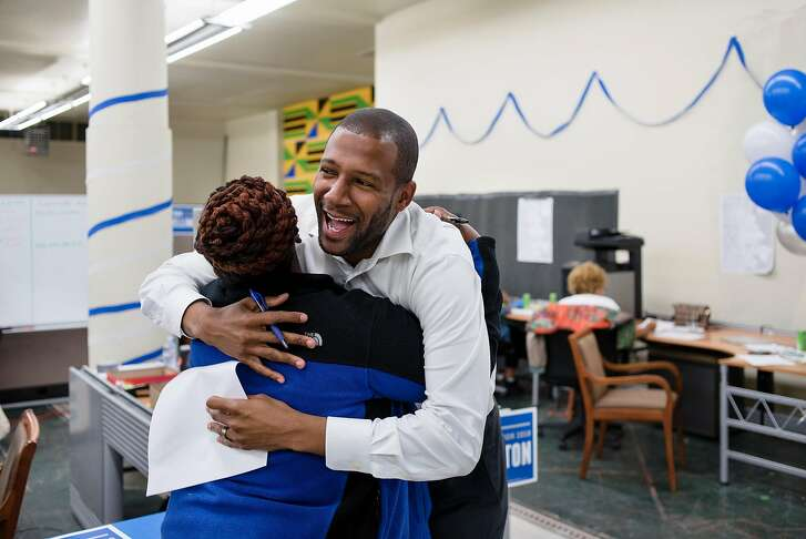 San Francisco district 10 supervisor candidate Theo Ellington gets a hug from volunteer April Spears, owner of nearby Auntie April�s Chicken-n-Waffles, during a phone banking party at his campaign headquarters in San Francisco, CA, on Tuesday September 18, 2018.