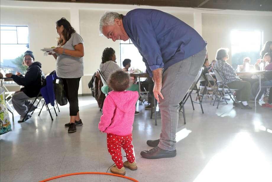 San Francisco District 10 supervisor candidate Tony Kelly talks to a child at bingo night at Sunnydale Community Center. Photo: Scott Strazzante / The Chronicle