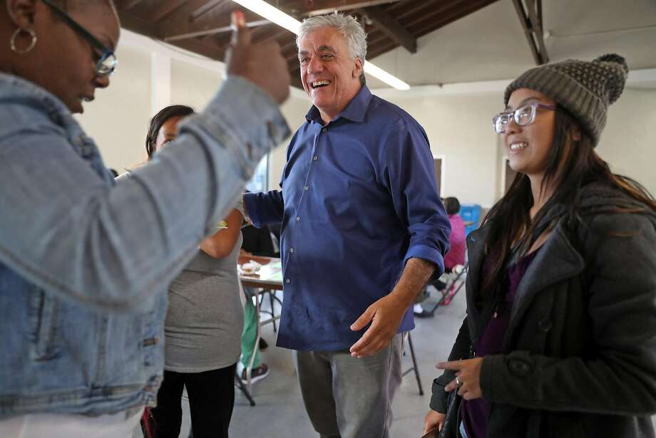 San Francisco Disctrict 10 supervisor candidate Tony Kelly chats at bingo night at the Sunnydale Community Center. Photo: Scott Strazzante / The Chronicle