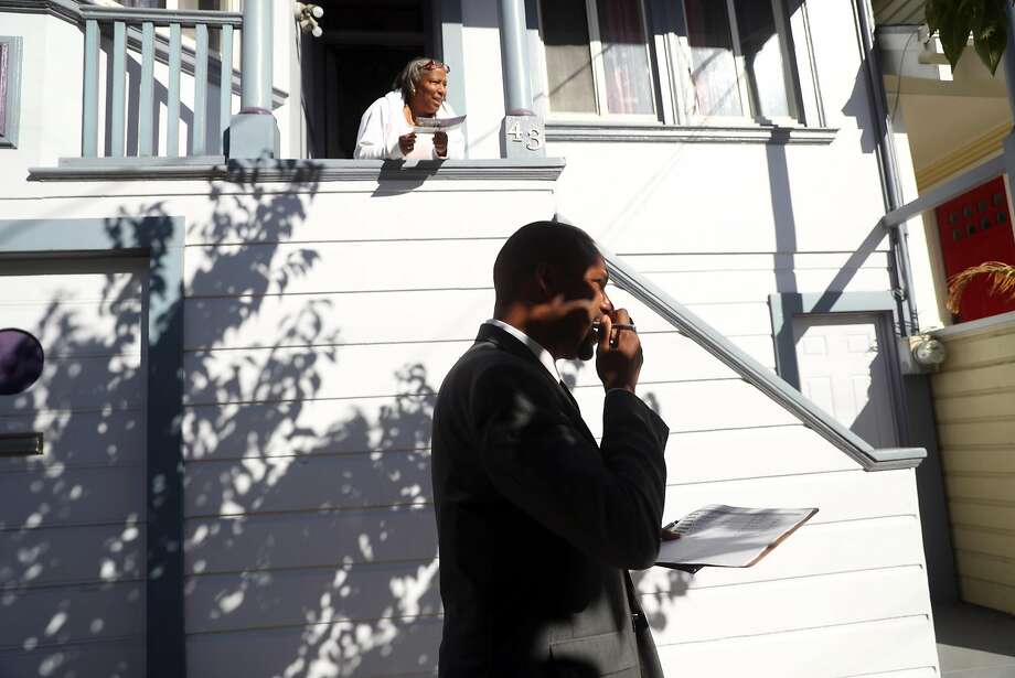 San Francisco District 10 Supervisor candidate Shamann Walton passes Michelle Williams after chatting with her while campaigning on Latona Street in San Francisco. Photo: Scott Strazzante / The Chronicle