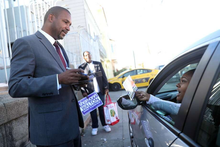 District 10 Supervisor candidate Shamann Walton chats with Johnesha Broomfield while campaigning on Latona Street in San Francisco, Calif. on Monday, September 17, 2018. Photo: Scott Strazzante / The Chronicle
