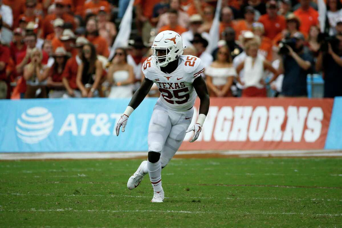 Texas Longhorns safety B.J. Foster defends during the first half of an NCAA college football game against the Oklahoma Sooners, Saturday, Oct. 6, 2018, in Dallas, Texas. (AP Photo/Roger Steinman)