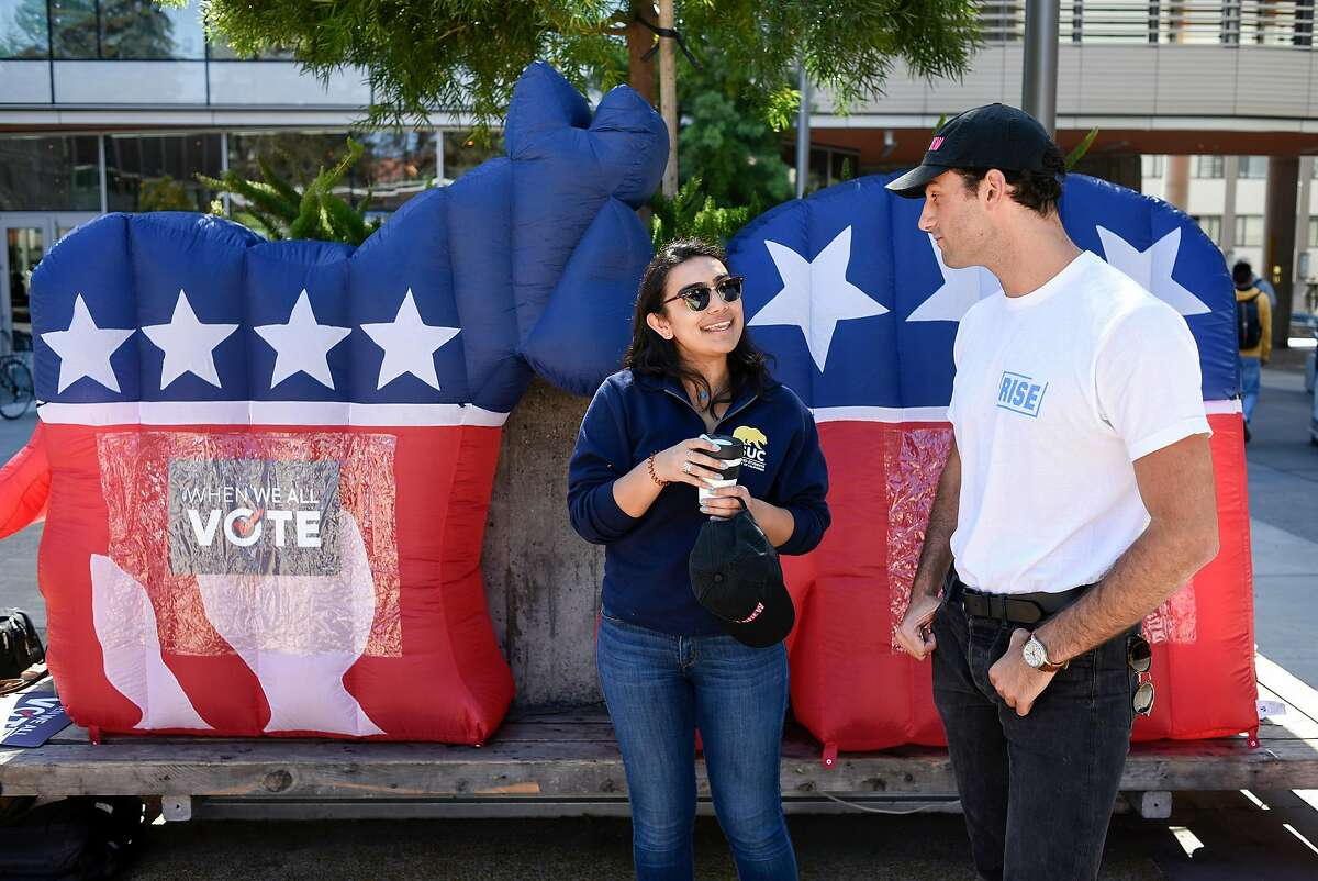 VoteCrew creator and Rise California member Maxwell Lubin, right, talks with Associated Students of the University of California external vice president Nuha Khalfay during a VoteCrew event encouraging students to vote during National Voter Registration Day on the UC Berkeley campus in Berkeley, Calif., on Tuesday September 25, 2018