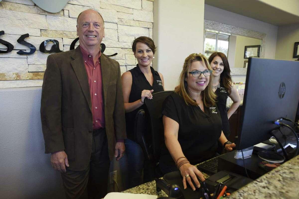 Dr. Steven Shuel, left, founder of Oak Haven Massage, stands with employees Lindsey Hoggard, Darlene Akeroyd and Christina Cruz on Wednesday, Sept. 5, 2018.