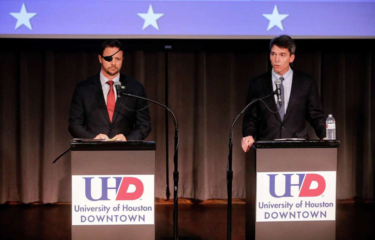Republican Dan Crenshaw, left, and Democrat Todd Litton, right, candidates for Congressional District 2, are shown during a debate at the University of Houston-Downtown Wednesday, Sept. 26, 2018.