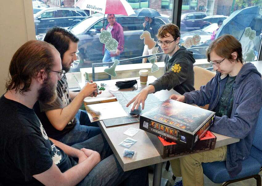 Friends, from left, Jacob Staub, Spencer Owen, Cody Carlson and Hunter Gray play CLANK at the city's first Board Game Café, Bard & Baker Thursday Oct. 11, 2018 in Troy, NY. (John Carl D'Annibale/Times Union)