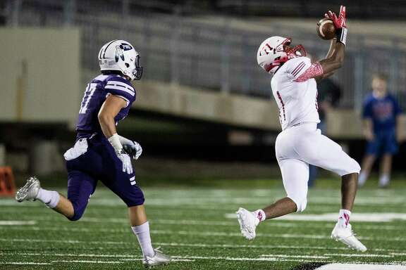 Crosby wide receiver Cedric Patterson III (11) beats Port Neches-Groves defensive back Zane Hernandez (17) for a 91-yard touchdown reception during the first quarter of a Class 5A bi-district playoff football game at Stallworth Stadium on Friday, Nov. 17, 2017, in Baytown. ( Brett Coomer / Houston Chronicle )