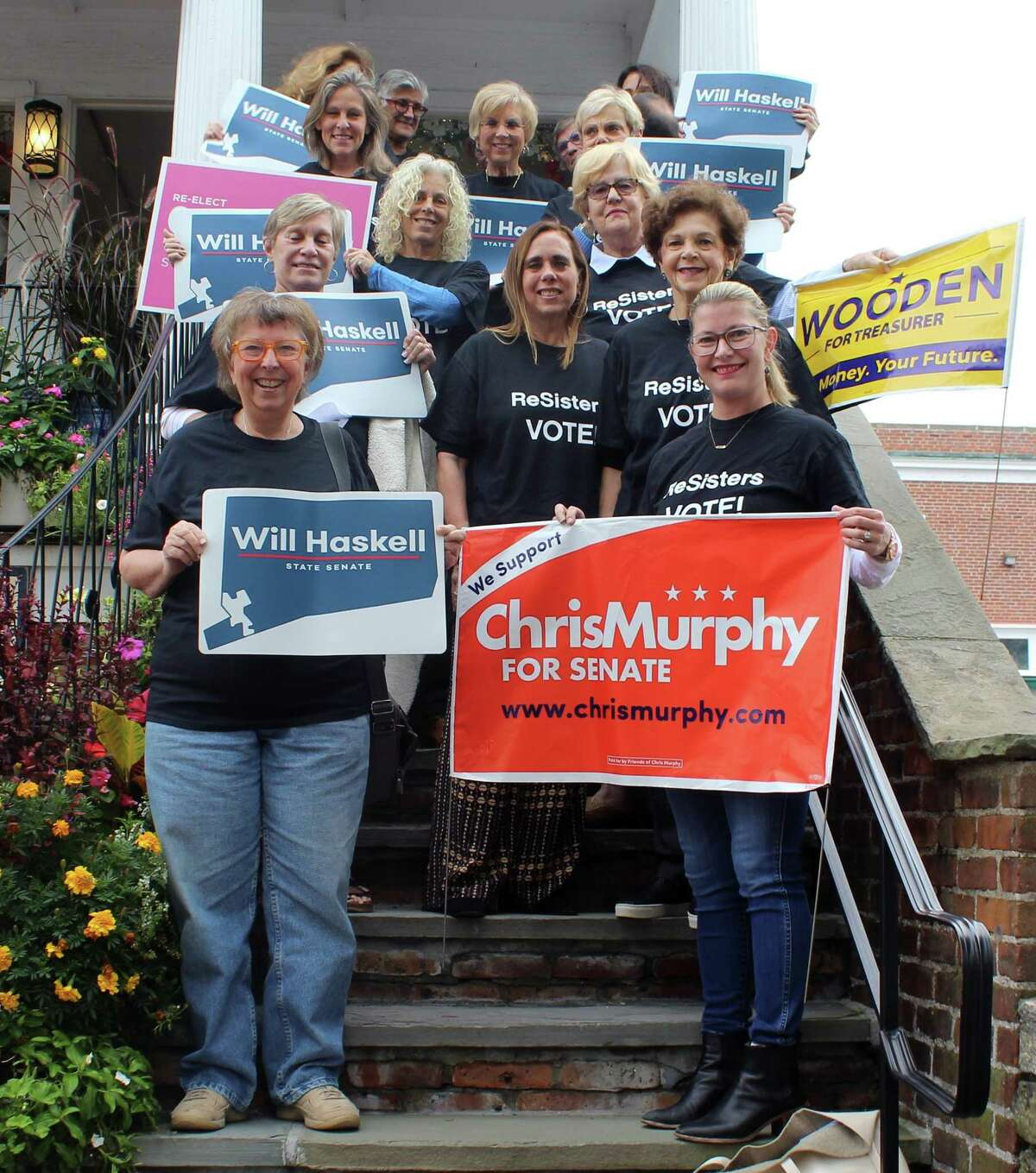 The Westport-based political organizing group the Resisters poses in downtown Westport on Oct. 1.