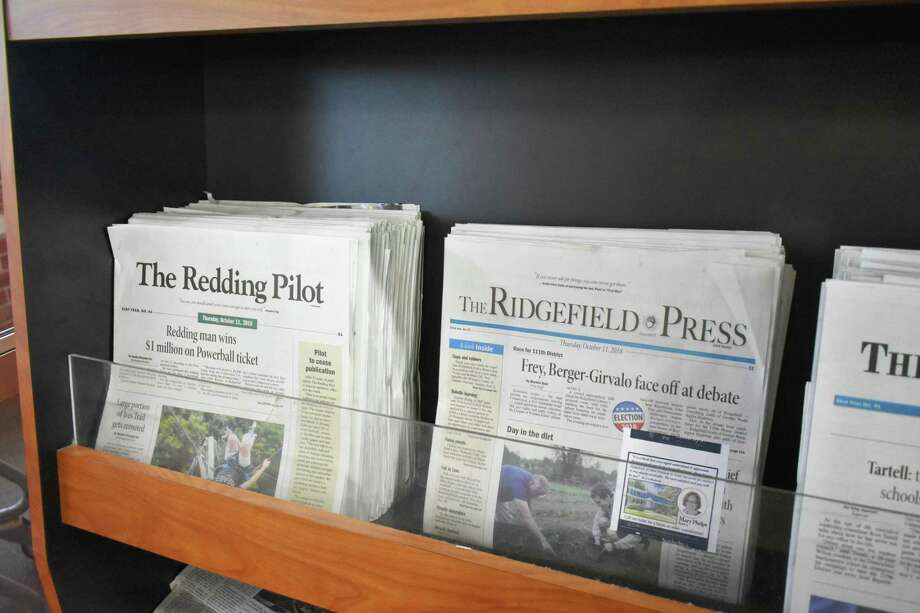 The Redding Pilot and The Ridgefield Press on a rack on in Redding on Thursday. Publisher HAN Network announced plans to cease publication of The Redding Pilot and four other weekly newspapers in southwestern Connecticut, while continuing the Ridgefield Press and 10 more in the region. Photo: Alexander Soule / Hearst Connecticut Media / Stamford Advocate